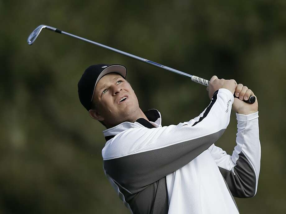 San Francisco Giants pitcher Matt Cain follows his shot from the third tee of the Monterey Peninsula Country Club Shore Course during the first round of the AT&T Pebble Beach Pro-Am golf tournament Thursday, Feb. 7, 2013, in Pebble Beach, Calif. (AP Photo/Ben Margot) Photo: Ben Margot, Associated Press