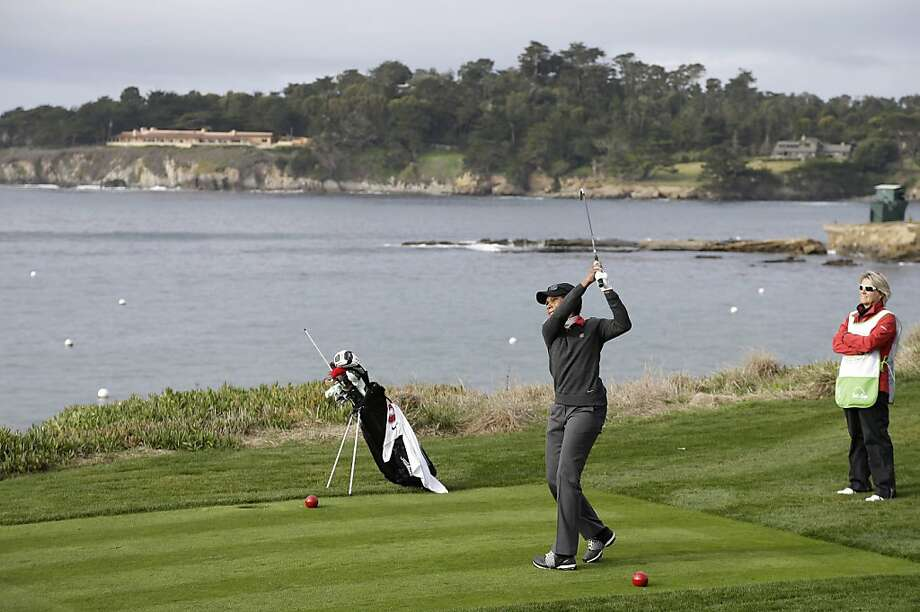 Former Secretary of State Condoleezza Rice hits from the fifth tee of the Pebble Beach Golf Links during the first round of the AT&T Pebble Beach Pro-Am golf tournament Thursday, Feb. 7, 2013, in Pebble Beach, Calif. (AP Photo/Eric Risberg) Photo: Eric Risberg, Associated Press