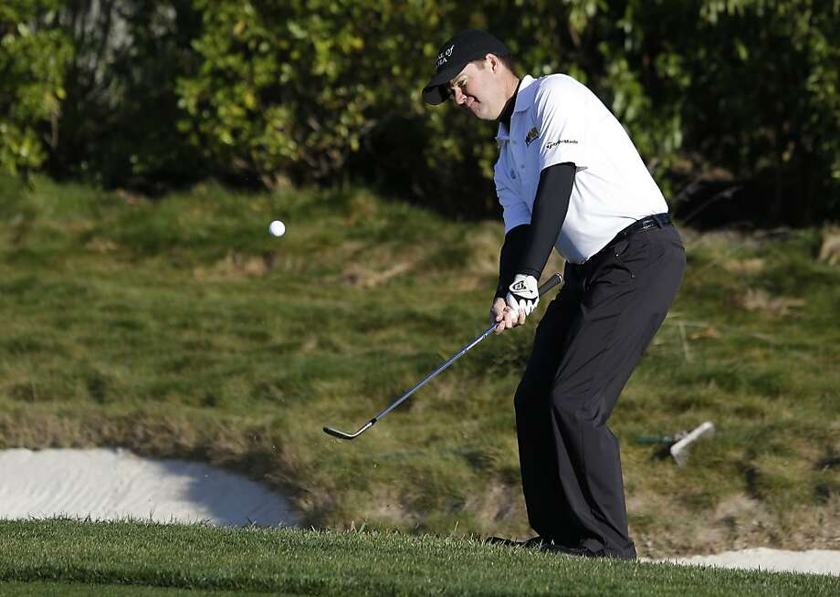 Joe Ogilvie chips the ball onto the first green of the Pebble Beach Golf Links during the first round of the AT&T Pebble Beach Pro-Am golf tournament  Thursday, Feb. 7, 2013 in Pebble Beach, Calif. (AP Photo/Eric Risberg) Photo: Eric Risberg, Associated Press