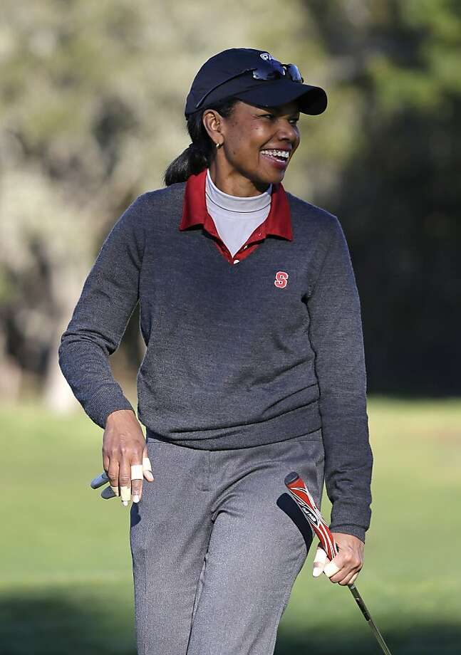 Former Secretary of State Condoleezza Rich smiles after making a putt to save par on the second green of the Pebble Beach Golf Links during the first round of the AT&T Pebble Beach Pro-Am golf tournament Thursday, Feb. 7, 2013, in Pebble Beach, Calif. (AP Photo/Eric Risberg) Photo: Eric Risberg, Associated Press