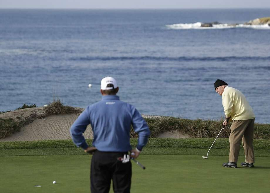 Lee Westwood, left, of England watches as his father John Westwood putts on the fourth green of the Pebble Beach Golf Links during the first round of the AT&T Pebble Beach Pro-Am golf tournament Thursday, Feb. 7, 2013, in Pebble Beach, Calif. (AP Photo/Eric Risberg) Photo: Eric Risberg, Associated Press