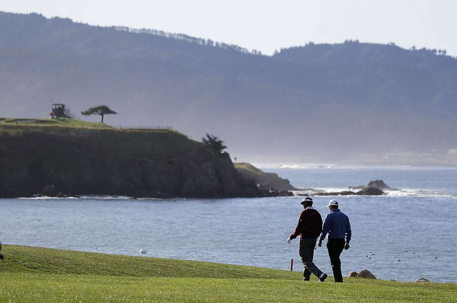 Vijay Singh, left, of Fiji and Lee Westwood, right, of England walk up the fourth fairway of the Pebble Beach Golf Links during the first round of the AT&T Pebble Beach Pro-Am golf tournament Thursday, Feb. 7, 2013, in Pebble Beach, Calif. (AP Photo/Eric Risberg) Photo: Eric Risberg, Associated Press