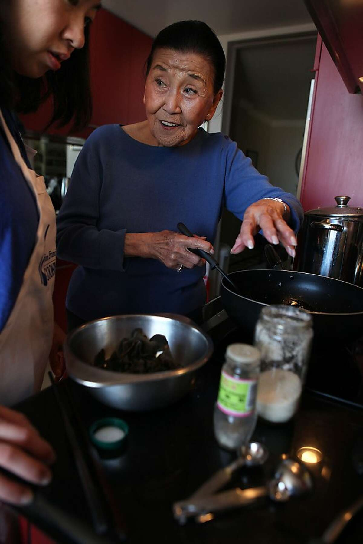 Cecilia Chiang showing Janny Hu how to make recipes for Chinese New Year at her home in San Francisco, Calif., on Friday, January 25, 2013.