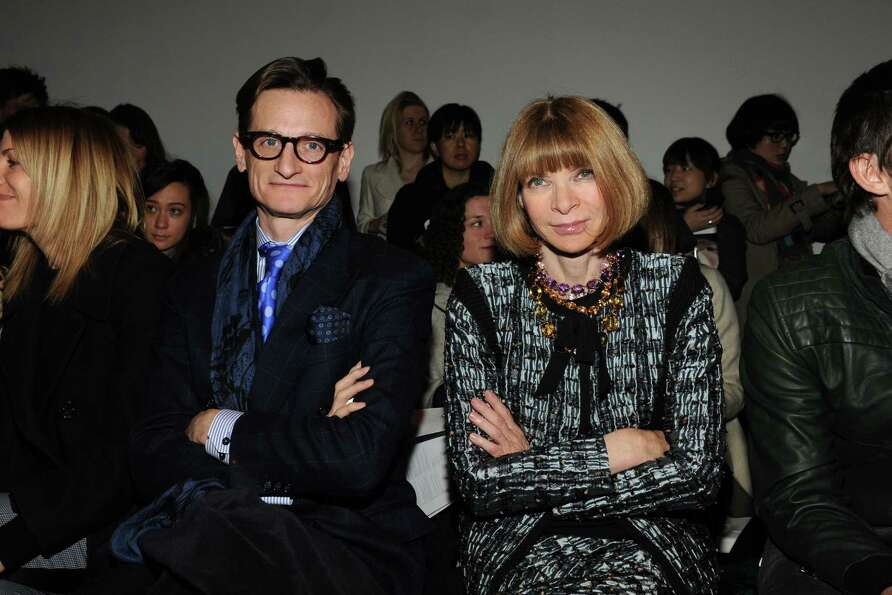 Anna Wintour and Hamish Bowles attend the Creatures of the Wind fall 2013 fashion show during Merced