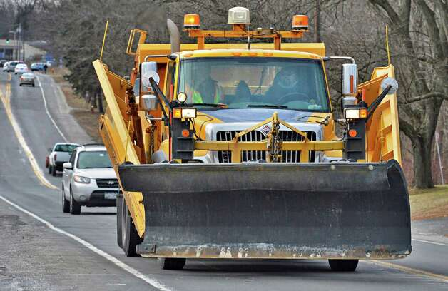 A NYS DOT snowplow on Watervliet Shaker Road Thursday Feb. 7, 2013.  (John Carl D'Annibale / Times Union) Photo: John Carl D'Annibale / 10021077A