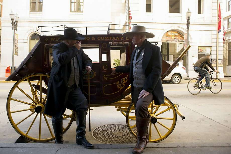Sure wish we had some quarter horses: Frank Jenkins and R.M. Parker stand by a quarter-scale replica of a Wells Fargo stagecoach in Knoxville, Tenn. The two belong to the Smoky Mountain Shootist Society, whose members participate in competitive shooting while dressed in Old West-wear. Photo: Saul Young, Associated Press