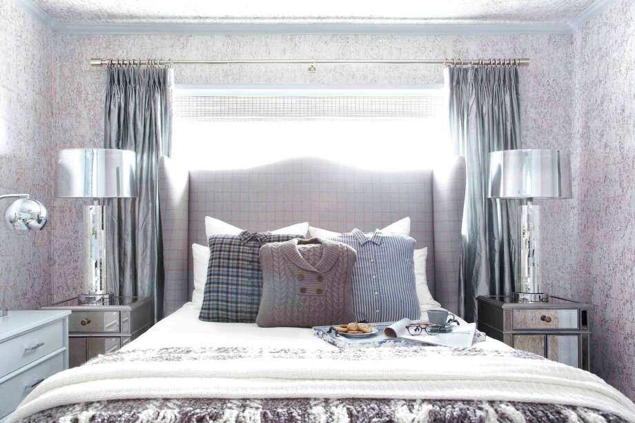 This publicity photo shows a guest bedroom by Designer Brian Patrick Flynn for HGTV.com that turns to wintry menswear for inspiration when creating wintry spaces. It includes a custom headboard made from men's suiting fabric featuring a check print, as well as pillows made from hand-me-down sweaters and flannel shirts. (AP Photo/Brian Patrick Flynn for HGTV.com, Daniel J. Collopy) Photo: Daniel J. Collopy
