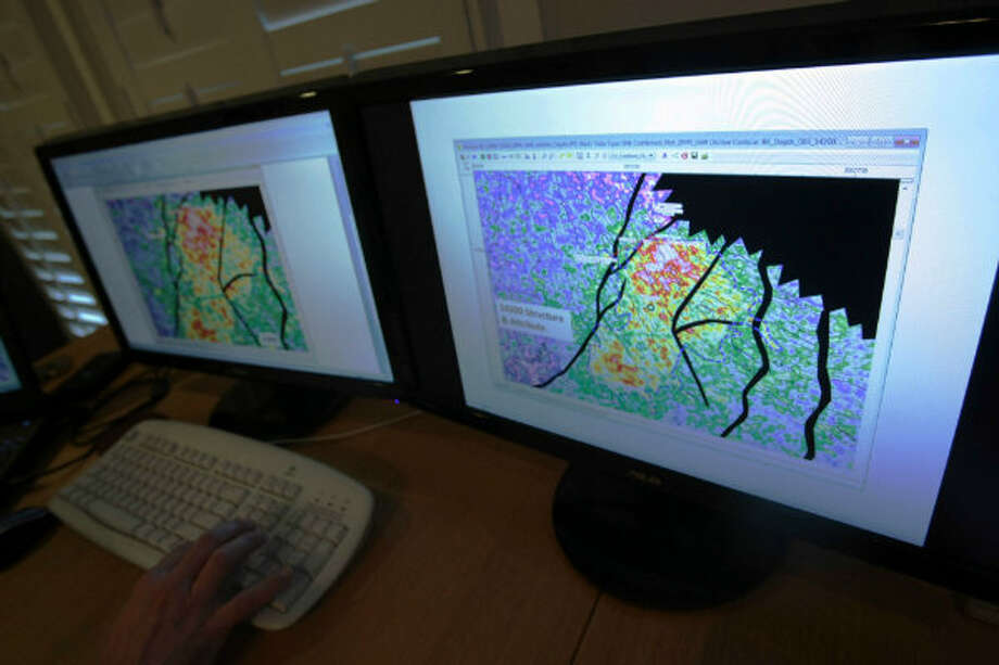 Geophysicist Brain Kalinec of I.P. Petroleum looks at geophysical maps of the Spindeltop area.