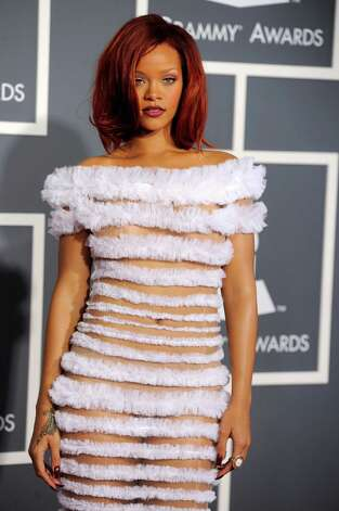 "FILE - This Feb. 13, 2011 file photo shows Rihanna at the 53rd annual Grammy Awards in Los Angeles. CBS has issued a memo to Grammy Awards attendees against baring too much skin at the ceremony Sunday. The network requests that ""buttocks and female breasts are adequately covered"" for the televised award show. The memo sent out Wednesday, Feb. 6, 2013, also warned against ""see-through clothing,"" exposure of ""the genital region"" and said that ""thong type costumes are problematic."" Photo: Chris Pizzello"