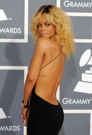 "FILE - This Feb. 12, 2012 file photo shows Rihanna at the 54th annual Grammy Awards in Los Angeles. CBS has issued a memo to Grammy Awards attendees against baring too much skin at the ceremony Sunday. The network requests that ""buttocks and female breasts are adequately covered"" for the televised award show. The memo sent out Wednesday, Feb. 6, 2013, also warned against ""see-through clothing,"" exposure of ""the genital region"" and said that ""thong type costumes are problematic."" Photo: Chris Pizzello"