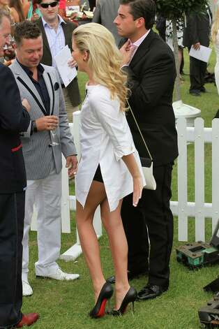 Definitely shoulda worn pants. (Lydia Bright at The Duke of Essex Polo on July 9, 2011).  Photo: Neil Mockford, Getty Images / 2011 Getty Images