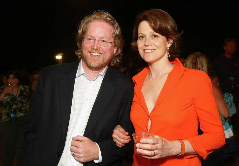 Hate it when the blouse gapes open between the buttons. Here's Sigourney Weaver and director Andrew Stanton at a party for the movie Wall-E. Photo: Alberto E. Rodriguez, Getty Images / 2008 Getty Images