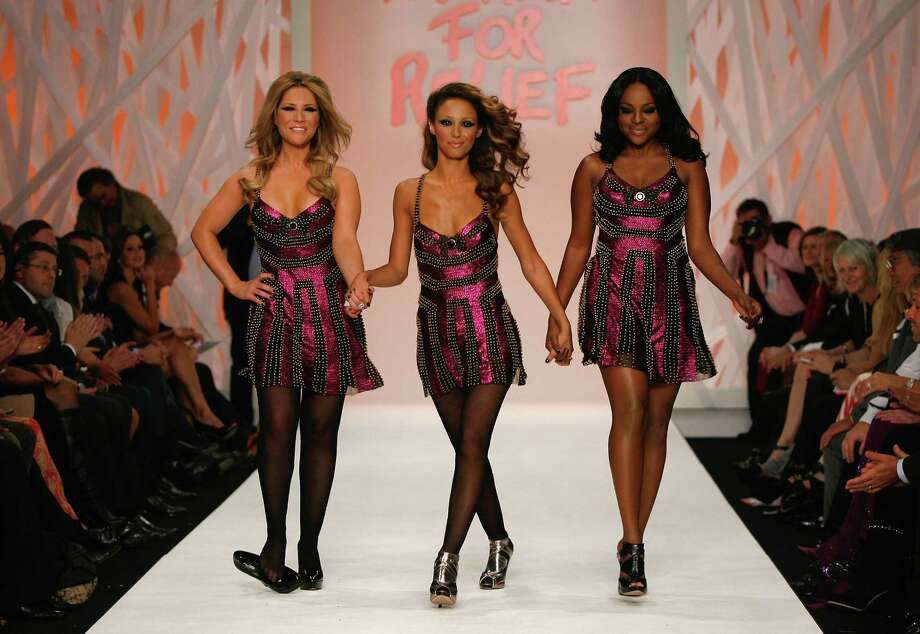 Someone's shoe fell off during the Sugababes' walk down the runway during London Fashion Week.  Photo: Gareth Cattermole, Getty Images / 2008 Getty Images