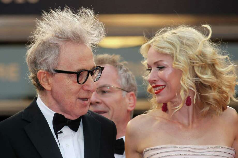Not really a wardrobe malfunction, more a bad hair day on Woody Allen, with  Naomi Watts at the Cannes Film Festival. Photo: VALERY HACHE, AFP/Getty Images / 2011 AFP