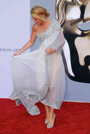 Blake Lively poses herself and her dress at a BAFTA Brits To Watch event in Los Angeles.  Photo: Kevork Djansezian, Getty Images / 2011 Getty Images