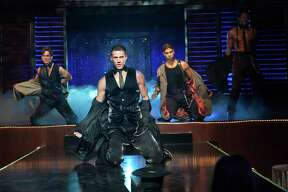 """In an undated handout photo, from left: Matt Bomer, Channing Tatum, Adam Rodriguez and Joe Manganiello in the 2012 Warner Brothers' film """"Magic Mike,"""" directed by Steven Soderbergh. A slow three months at the box office for Warner Brothers movies and continued sluggishness at Time Inc. magazines contributed to a 32.6 percent decline in net income at Time Warner. (Claudette Barius/Warner Brothers Pictures via The New York Times) -- NO SALES; FOR EDITORIAL USE ONLY WITH STORY SLUGGED TIME WARNER EARNINGS BY AMY CHOZICK. ALL OTHER USE PROHIBITED. --"""