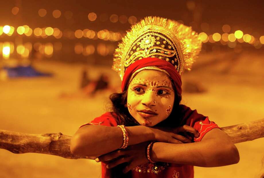 In this late Friday, Feb. 1, 2013 photo, an Indian child dressed as a Hindu Goddess watches a religious procession towards the Sangam, the confluence of rivers Ganges, Yamuna and mythical Saraswati, as part of the Maha Kumbh festival in Allahabad, India. Millions of Hindu pilgrims are expected to attend the Maha Kumbh festival, which is one of the world's largest religious gatherings that lasts 55 days and falls every 12 years. Photo: AP