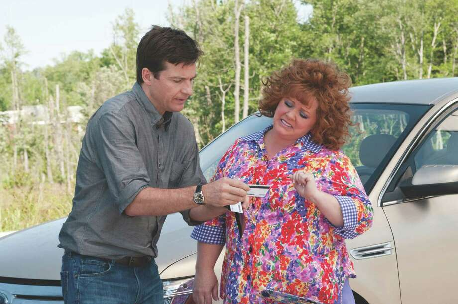 "JASON BATEMAN and MELISSA MCCARTHY lead the cast of ""Identity Thief"",  Photo Credit: Guy D'Alema/Universal Studios."