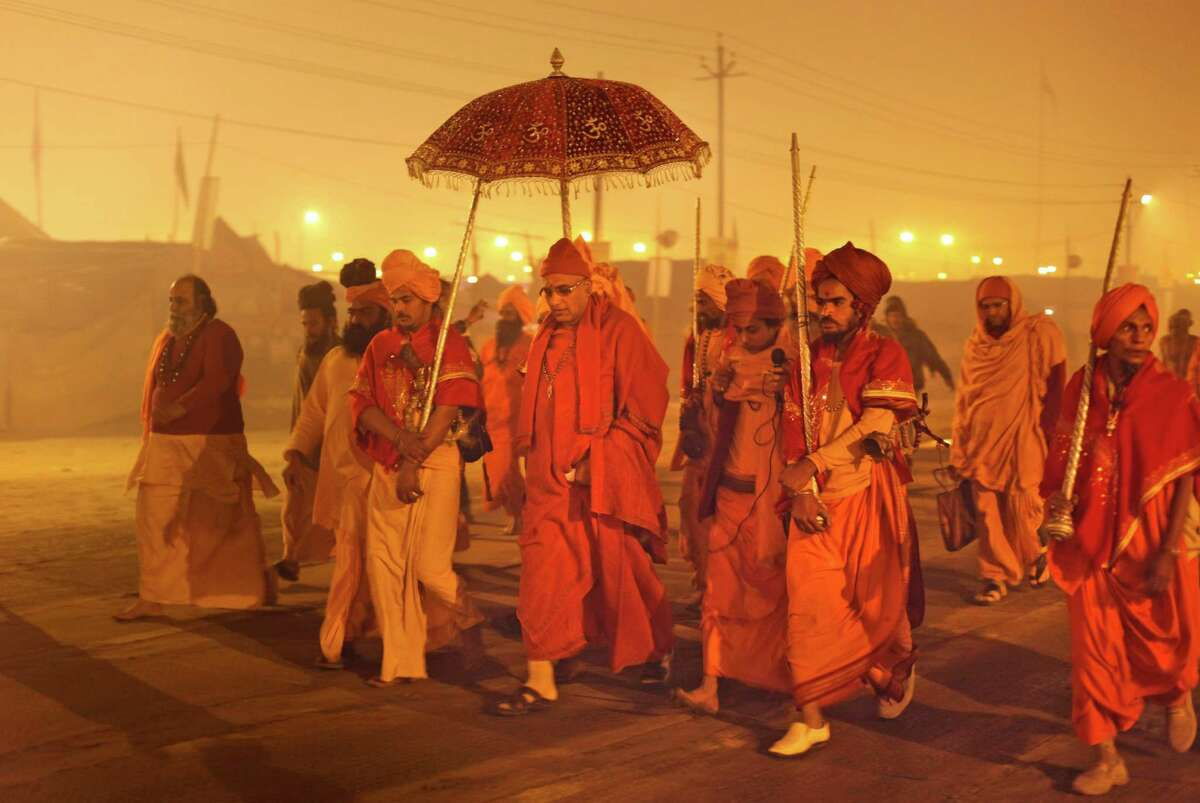 Leader Swami Avdheshanand Giri, center, arrives to initiate Hindu holy men of the Juna Akhara during rituals that is believed to rid them of all ties in this life and dedicate themselves to serving God as a 'Naga' or naked holy men, at Sangam, the confluence of the Ganges and Yamuna River during the Maha Kumbh festival in Allahabad, India, early Thursday, Jan. 31, 2013. The significance of nakedness is that they will not have any worldly ties to material belongings, even something as simple as clothes. This ritual that transforms selected holy men to Naga can only be done at the Kumbh festival.