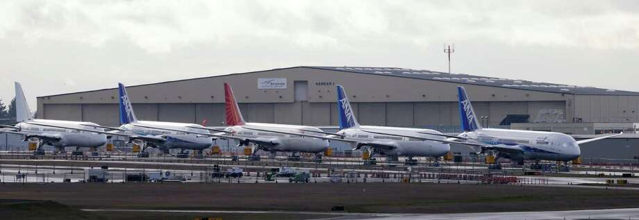 A line of Boeing 787 jets are parked Thursday, Feb. 7, 2013, at Paine Field in Everett, Wash., following a flight from Texas. Photo: AP