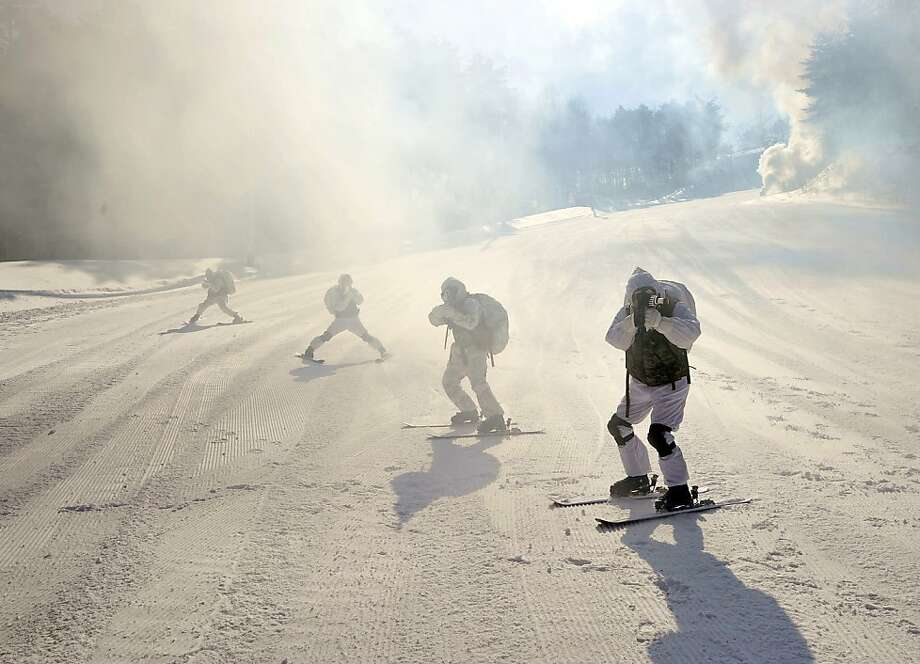 We told you this trail was closed!Marines from South Korea and the United States take aim as they ski down a hill during a joint winter drill in Pyeongchang. Photo: Jung Yeon-Je, AFP/Getty Images