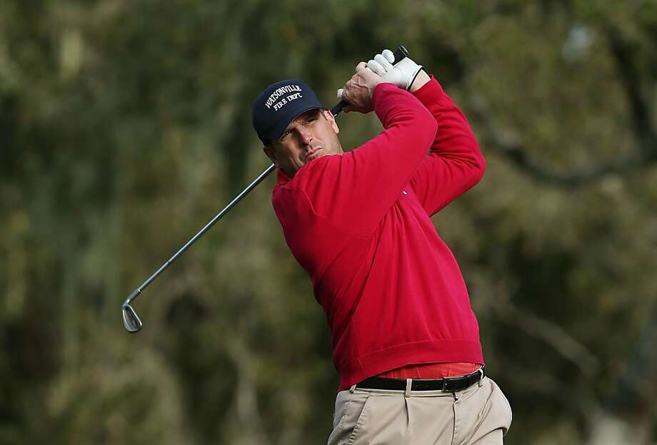 PEBBLE BEACH, CA - FEBRUARY 07:  San Francisco 49ers head coach Jim Harbaugh hits a shot on the third hole during the first round of the AT&T Pebble Beach National Pro-Am at the Monterey Peninsula Country Club on February 7, 2013 in Pebble Beach, California.  (Photo by Jeff Gross/Getty Images) Photo: Jeff Gross, Getty Images