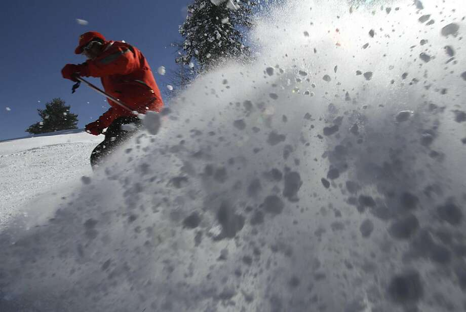 Enjoy it while it lasts:A man skis down a slope at Gulmarg, an Indian ski resort about 35 miles from Srinagar. It's not a well-known ski destination, no doubt because it gets only between three and five feet of snow during the winter. Photo: Mukhtar Khan, Associated Press