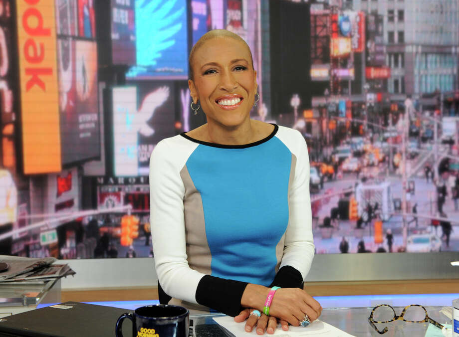 "This Jan. 24, 2013 photo released by ABC shows Robin Roberts on ""Good Morning America,"" in New York. Roberts will be back on the job at the ""Good Morning America"" anchor desk on Feb. 20. Her return will be five months to the day since her bone marrow transplant to treat a rare blood disorder. (AP Photo/ABC, Ida Mae Astute) Photo: Ida Mae Astute"