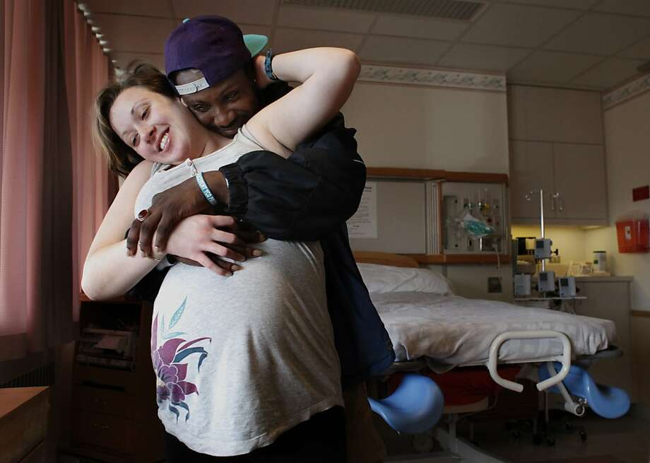 Caroline and Deon stand in a delivery room in the perinatal unit at San Francisco General Hospital. They're getting help from a program that caters to straight men who are HIV-positive and want to have a family. Photo: Lacy Atkins, The Chronicle
