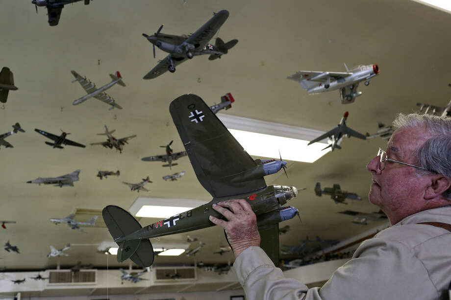"Rusty Landry hangs a model airplane on the ceiling at American Legion Post 157 in Bandera. Over the years, he constructed scores of the models, then donated them when his home became an ""air traffic controller's nightmare."" Photo: Lisa Krantz / San Antonio Express-News"