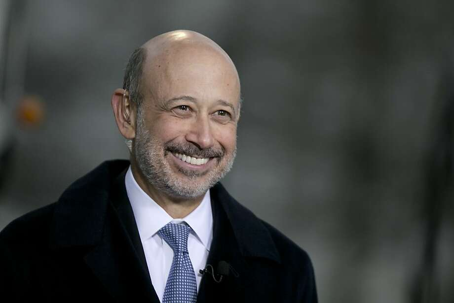 "Lloyd Blankfein, CEO of Goldman Sachs, smiles during a television interview Tuesday. ""After the fact,"" he has said, ""it is easy to be convinced that the signs were visible and compelling."" Photo: Andrew Harrer, Bloomberg"
