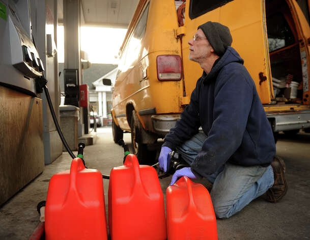 Eric Vollenweider of Bridgeport fills up three gas cans for his home generator in preparation for the coming snowstorm on Thursday, February 7, at the Cumberland Farms at 975 Kings Highway East in Fairfield. Photo: Brian A. Pounds
