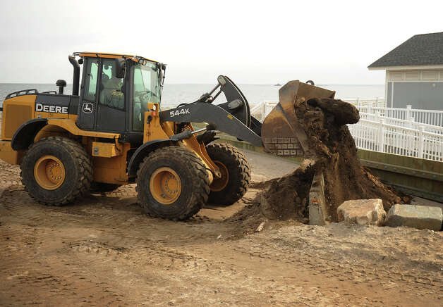 An earthen barrier is constructed to block potential flood waters from the coming storm at Penfield Beach in Fairfield on Thursday, February 7, 2013. Photo: Brian A. Pounds