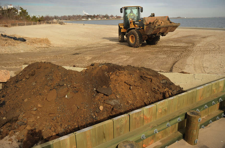 An earthen barrier is constructed to block potential flood waters from the coming storm at Penfield Beach in Fairfield on Thursday, February 7, 2013. Photo: Brian A. Pounds / Connecticut Post