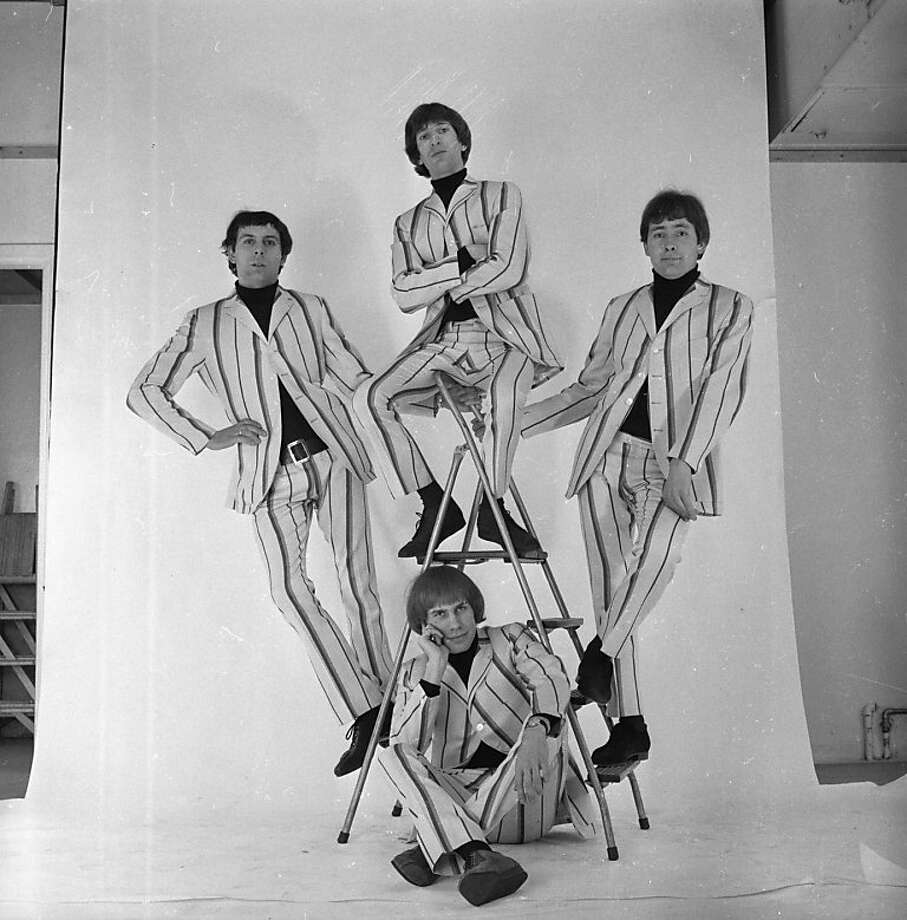 "Reg Presley (right), Chris Britton, Peter Staples and Ronnie Bond made up the British pop band the Troggs, who had a No. 1 U.S. hit with ""Wild Thing."" Photo: Harry Dempster, Getty Images"