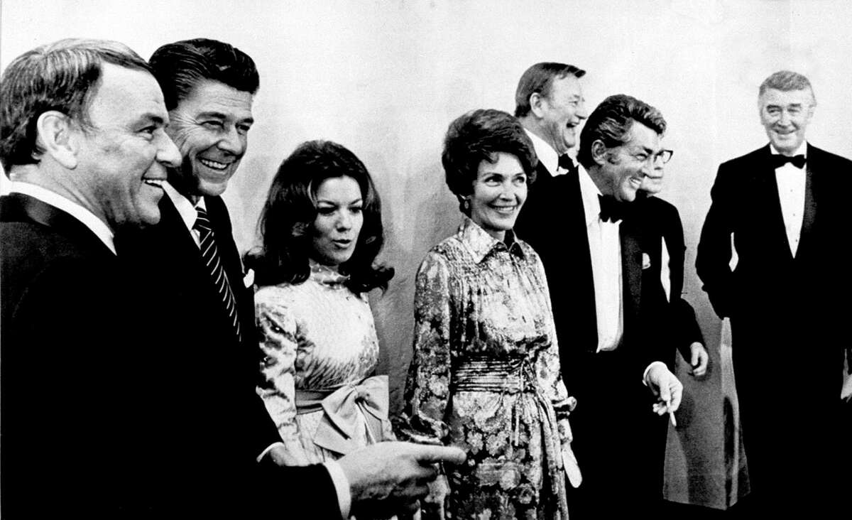 California Gov. Ronald Reagan, second from left, is surrounded by supporters at his inaugural gala at Sacramento's Municipal auditorium, Ca., on Jan. 5, 1971. From left are, Frank Sinatra, Gov. Reagan, Vicki Carr, Nancy Reagan, Dean Martin, John Wayne, behind, Jack Benny, partially hidden, and Jimmy Stewart, far right. Reagan died at age 93 on June 5, 2004.