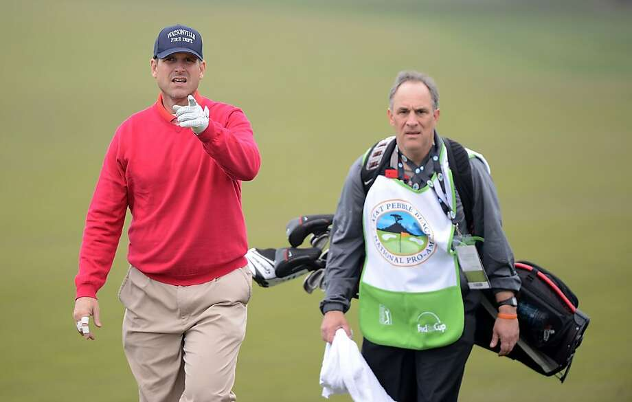 San Francisco 49ers head coach Jim Harbaugh walks with his caddie, Vic Fangio, during the first round of the AT&T Pebble Beach National Pro-Am at the Monterey Peninsula Country Club on February 7, 2013 in Pebble Beach, California.  (Photo by Harry How/Getty Images) Photo: Harry How, Getty Images