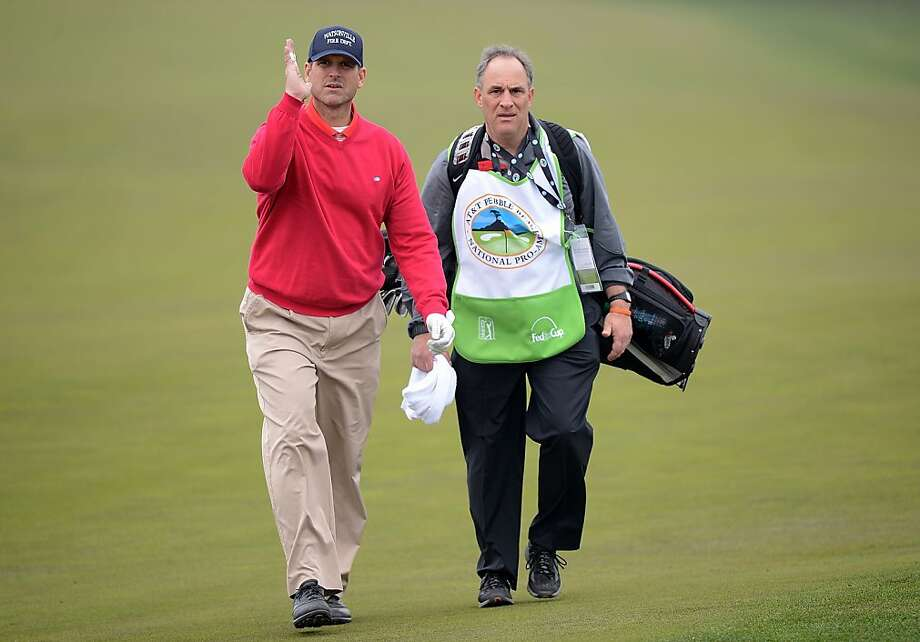 San Francisco 49ers head coach Jim Harbaugh walks with his caddie, Vic Fangio, during the first round of the AT&T Pebble Beach National Pro-Am at the Monterey Peninsula Country Club on February 7, 2013 in Pebble Beach, California. Photo: Harry How, Getty Images