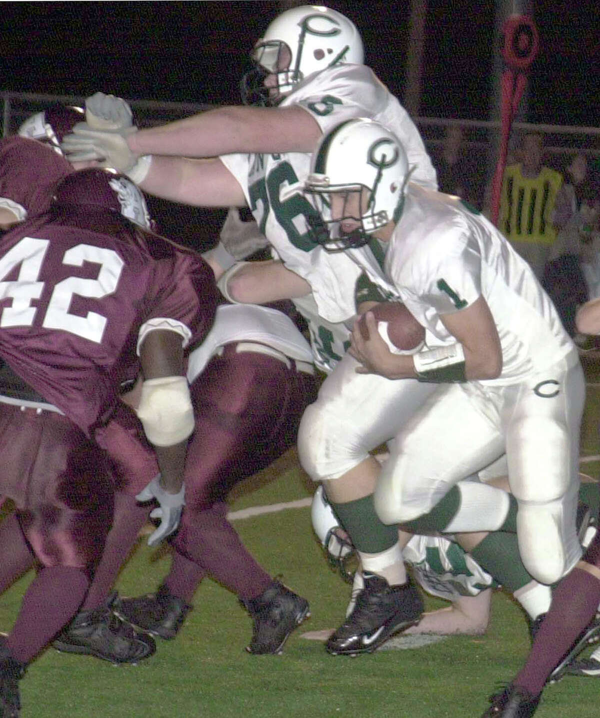 Canton quarterback G.J. Kinne (1) runs the ball against Athens High school Friday, Sept. 24, 2004, in Athens, Texas. Kinne threw for 465 yards and six touchdowns and ran for another score in his team's 47-21 win over Athens. (AP Photo/Athens Daily Review/Charles Stiff)