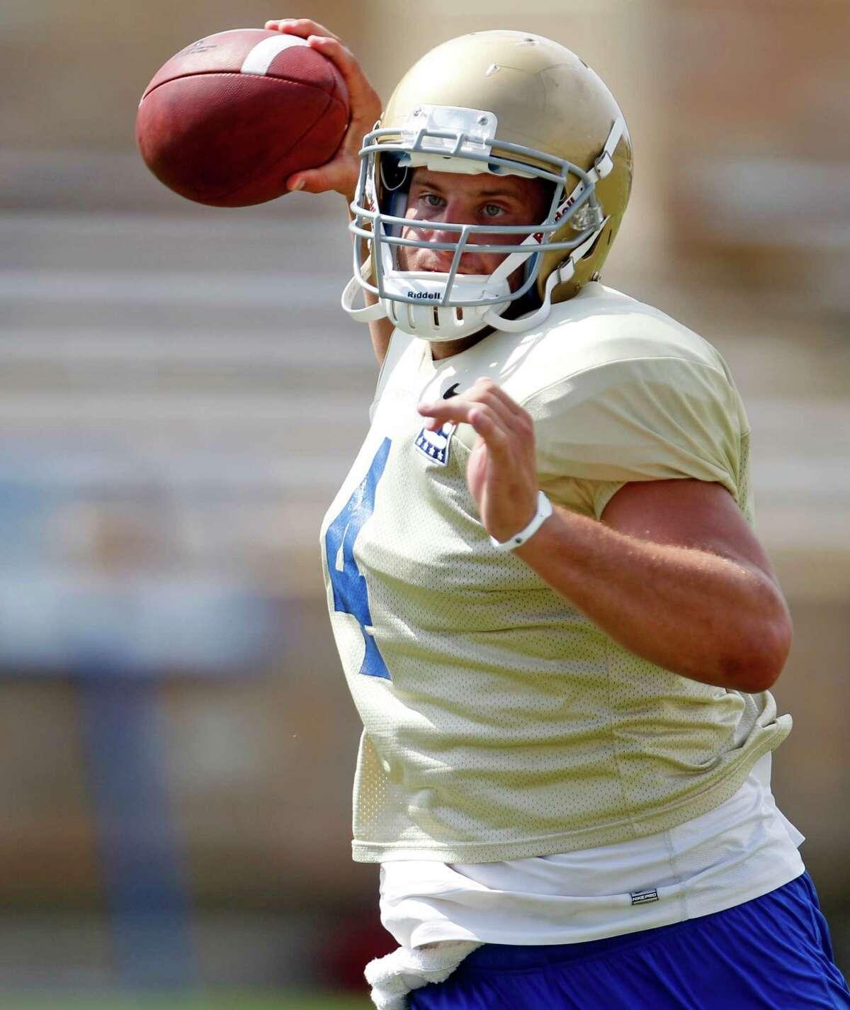 In this Wednesday, Aug 10, 2011 photo, Tulsa quarterback G.J. Kinne is pictured during a Tulsa football practice in Tulsa, Okla. (AP Photo/Sue Ogrocki)