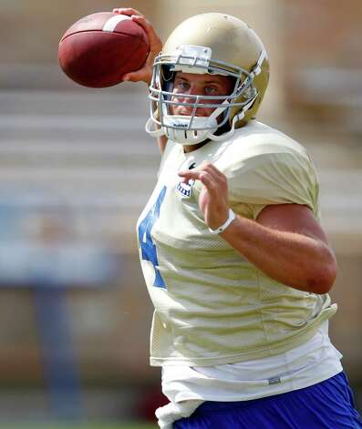In this Wednesday, Aug 10, 2011 photo, Tulsa quarterback G.J. Kinne is pictured during a Tulsa football practice in Tulsa, Okla. (AP Photo/Sue Ogrocki) Photo: Sue Ogrocki, Associated Press / AP