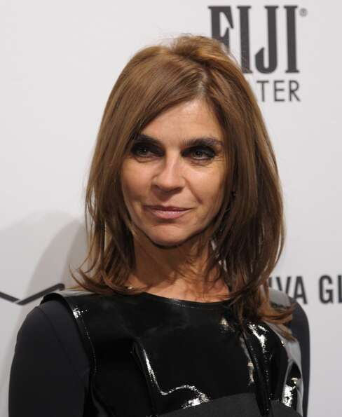 Carine Roitfeld arrives at the amfAR (The Foundation for AIDS Research) gala that kicks off the Merc