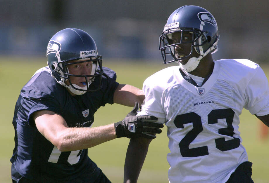 Seattle Seahawks wide receiver Jerheme Urban (10) blocks cornerback Marcus Trufant (23) out of a play during afternoon practice Tuesday, Aug. 12, 2003, at training camp in Cheney, Wash. (AP Photo/Jim Bryant) Photo: JIM BRYANT, Associated Press / AP