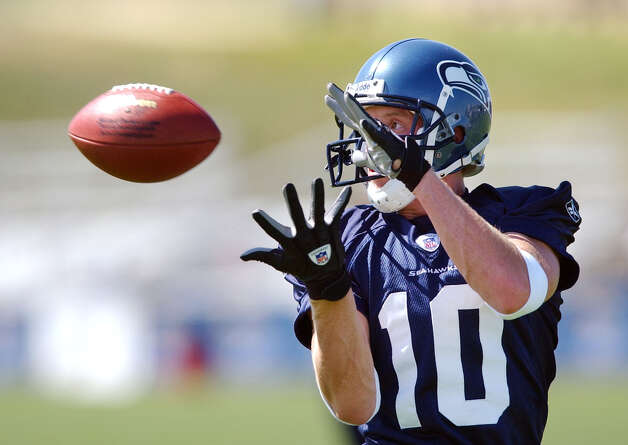 Seattle Seahawks wide receiver Jerheme Urban catches a pass during an afternoon drill at the team's opening day of training camp Saturday, July 26, 2003, in Cheney, Wash. (AP Photo/Elaine Thompson) Photo: ELAINE THOMPSON, Associated Press / AP
