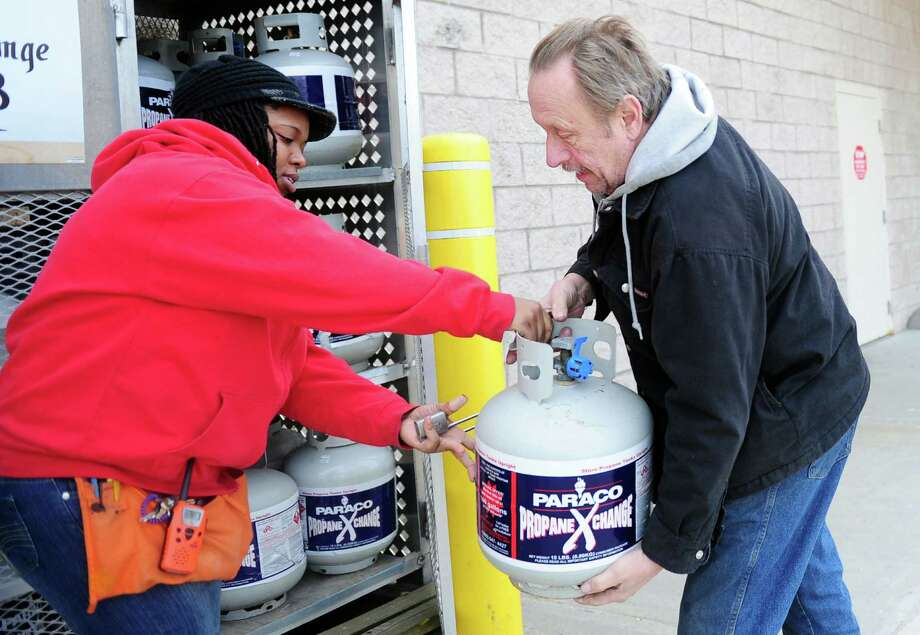 Al Rohe, of Shelton, picks up a new propane tank ahead of the forcasted snow storm Thursday, Feb. 7, 2013 at the Home Depot store in Derby, Conn.  Rohe lost power for an extended period of time during both Hurricanes Sandy and Irene. Photo: Autumn Driscoll
