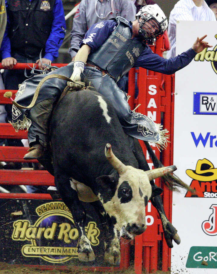 Corey Navarre, of Weatherford, OK, competes in the Xtreme Bulls event during the San Antonio Stock Show & Rodeo Saturday Feb. 20, 2010 at the AT&T Center. Navarre scored an 89 on the ride and went on to win the event. PHOTO BY EDWARD A. ORNELAS/eaornelas@express-news.net) Photo: EDWARD A. ORNELAS, Express-News / eaornelas@express-news.net