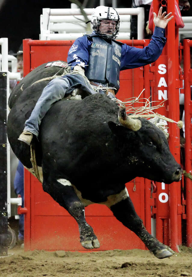 Corey Navarre of Weatherford, Oklahoma rides Resses Pieces during the bull riding competition at the 2010 San Antonio Stock Show and Rodeo and Lady Antebellum concert on Friday, Feb. 5, 2010. Kin Man Hui/kmhui@express-news.net Photo: Kin Man Hui, Express-News / San Antonio Express-News