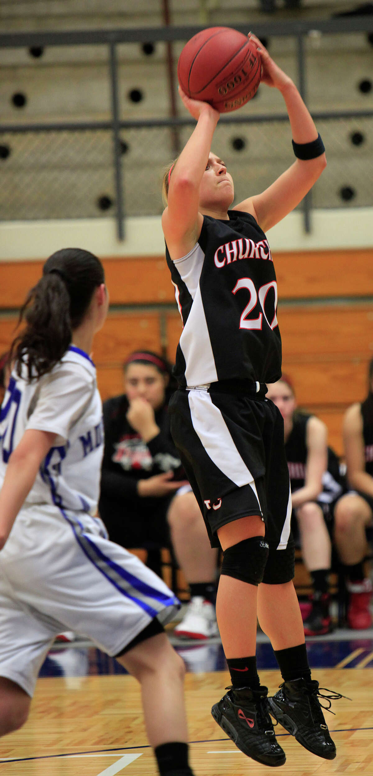 Churchill guard Leslie Vorpahl, 20, puts up a jump shot as the Lady Chargers beat the Jay Lady Mustangs 46-32 in non-district girls basketball, Tuesday, November 19, 2011, at Taylor Field House in San Antonio. Churchill with a 28-24 lead at the half. ( Photo by J. Michael Short / SPECIAL )