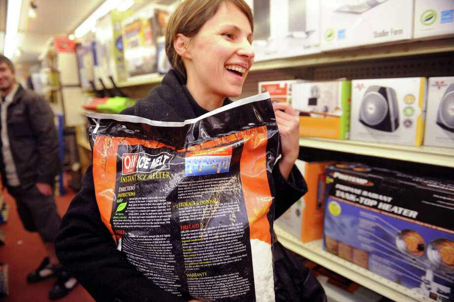Bridget Blank, of Greenwich, came to the Greenwich True Value Hardware Thursday, Feb. 7, 2013, in Greenwich, Conn., to get salt in preparation for the next day's snowstorm. Photo: Helen Neafsey / Greenwich Time