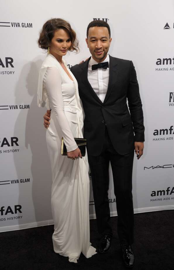 Singer John Legend (R) and Chrissy Teigen (L) arrive at the amfAR (The Foundation for AIDS Research) gala that kicks off the Mercedes-Benz Fashion Week February 6, 2013 in New York. Photo: STAN HONDA, AFP/Getty Images / AFP